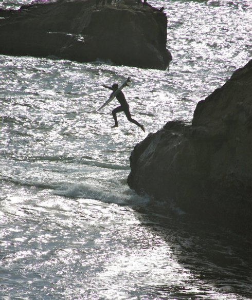 Jumping off of the rocks at Steamer Lane.