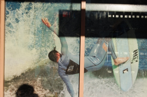 Local surfer Sean Fowler on the window of the Surf Hut.