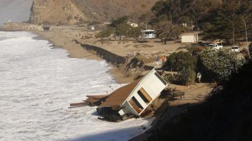 The historic lifeguard headquarters at Pt. Mugu State Beach was destroyed by large waves and coastal flooding.